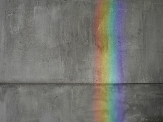 Refracted Rainbow on Grey Wall