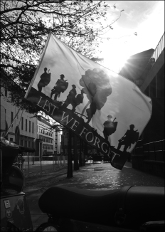 8. 2010 – 2020 Retrospective | In Mono | Remembrance flag attached to scooter | November 2019